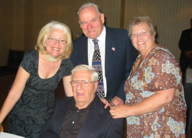 Bob O'Hara (Standing, Middle), Brenda Bowman (left), Sandra Archer (Right), and Verne Goodwin (Front), four Mira Mesa Volunteers of the Year.